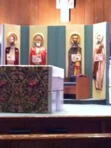 evangelists behind altar