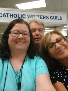 At the registration desk with Janet Willett. Photobomb courtesy of Ron O'Gorman.