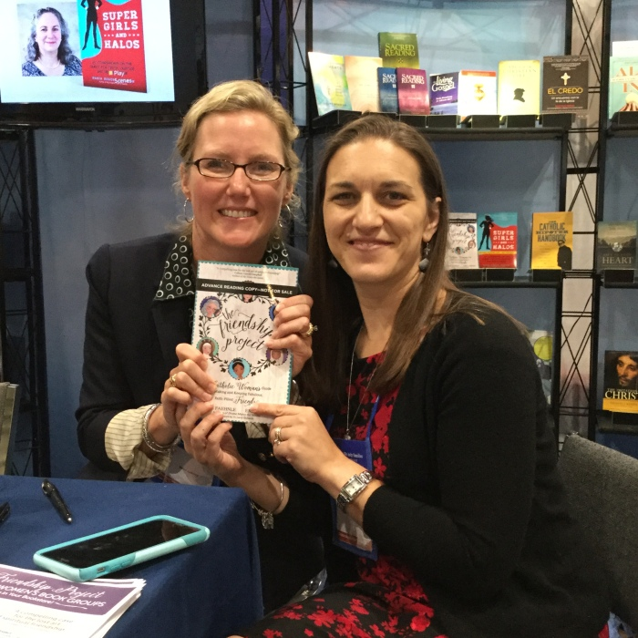 Emily Jaminet (l) and Michele Faehnle with advance copy of The Friendship Project at Catholic Marketing Network 2017. Photo copyright 2017 Barb Szyszkiewicz. All rights reserved.